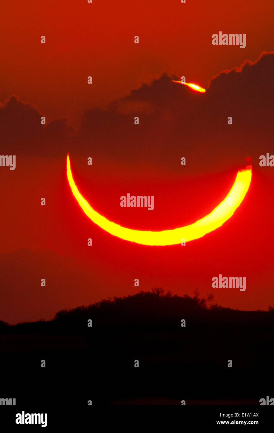 Annular solar eclipse of May 20th 2012. Photographed at sunset from western Texas. - Stock Image