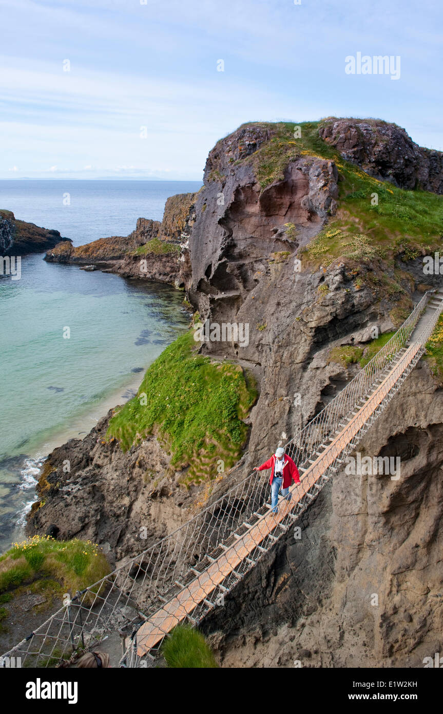 Carrick-a-Rede Rope Bridge at Carrickarede Isle, County Antrim, Northern Ireland - Stock Image