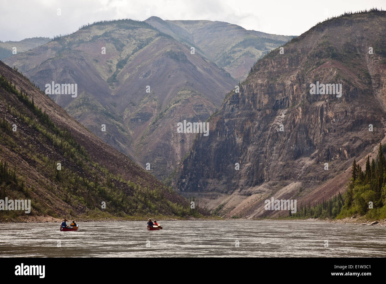 Two canoes in third canyon on Nahanni River, Nahanni National Park Preserve, NWT, Canada. - Stock Image
