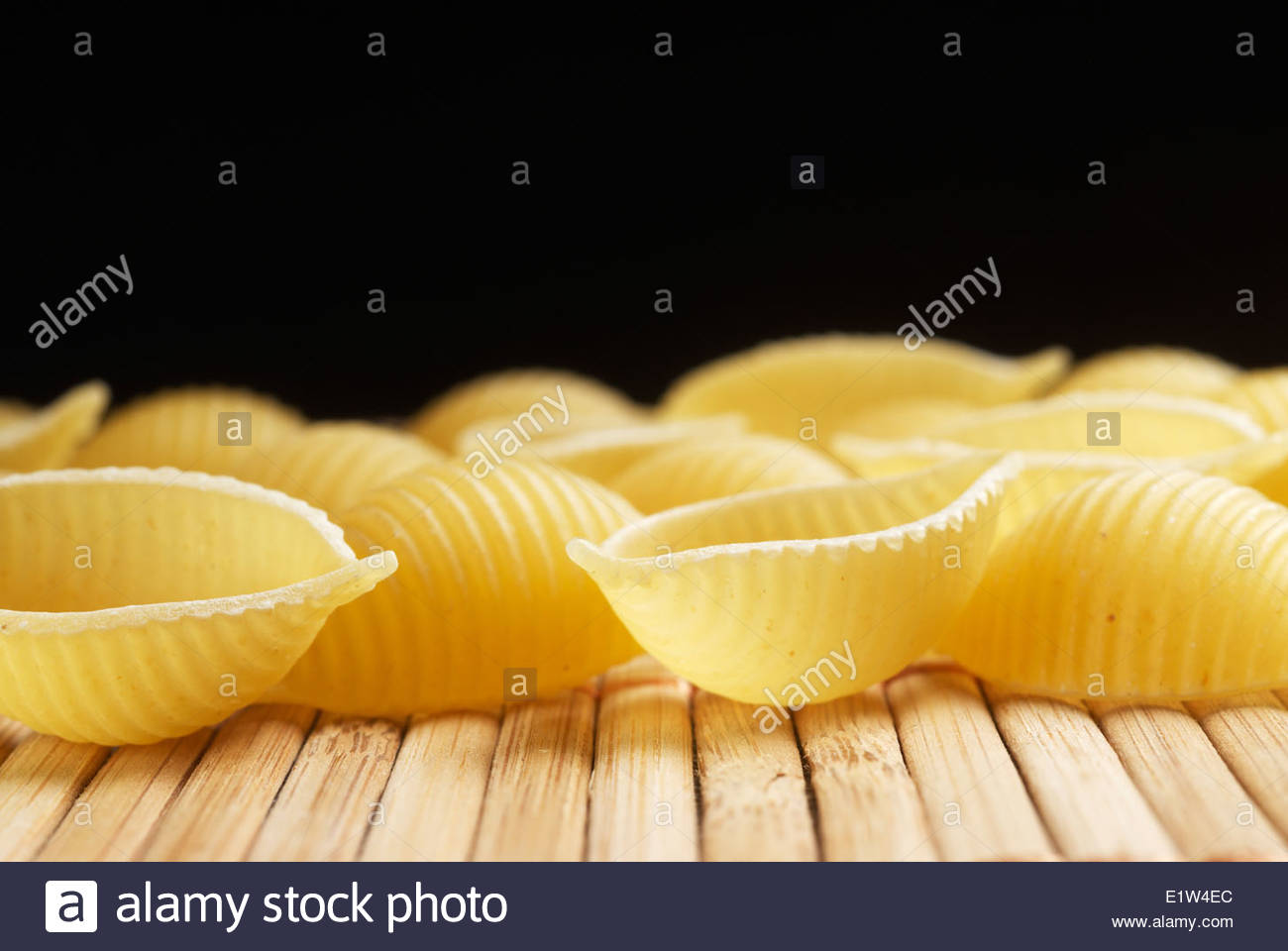 Raw pasta shells closeup - Stock Image