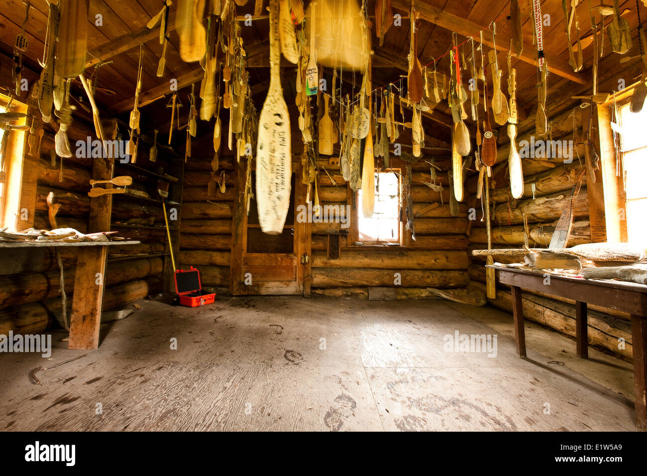 Old cabin with carved canoe paddles previous expeditions hang rafters (also called 'The Paddle Cabin at Prairie - Stock Image