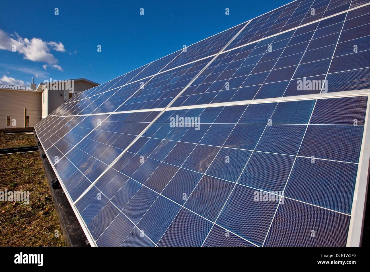 Solar panels on farm near Black Diamond, Alberta, Canada. - Stock Image