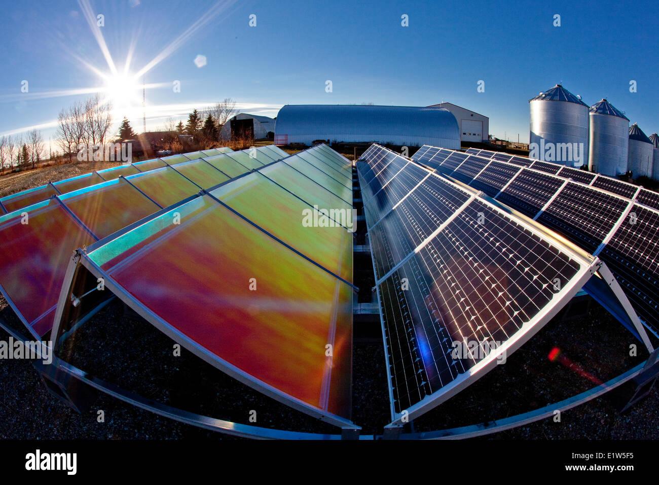 Solar panels and reflectors (to boost efficiency) on farm near Calgary, Alberta, Canada. - Stock Image
