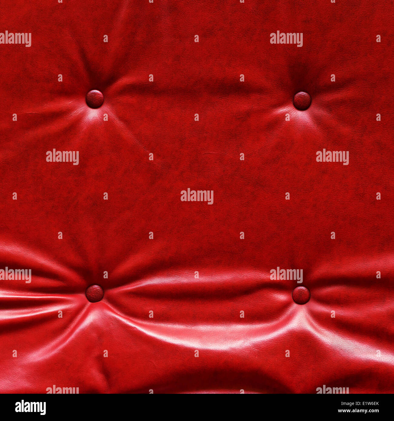 Buttoned upholstery Red leather texture as background. - Stock Image
