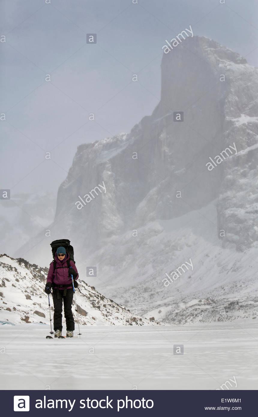 Woman ski touring in Auyuittuq National Park, Nunavut. - Stock Image