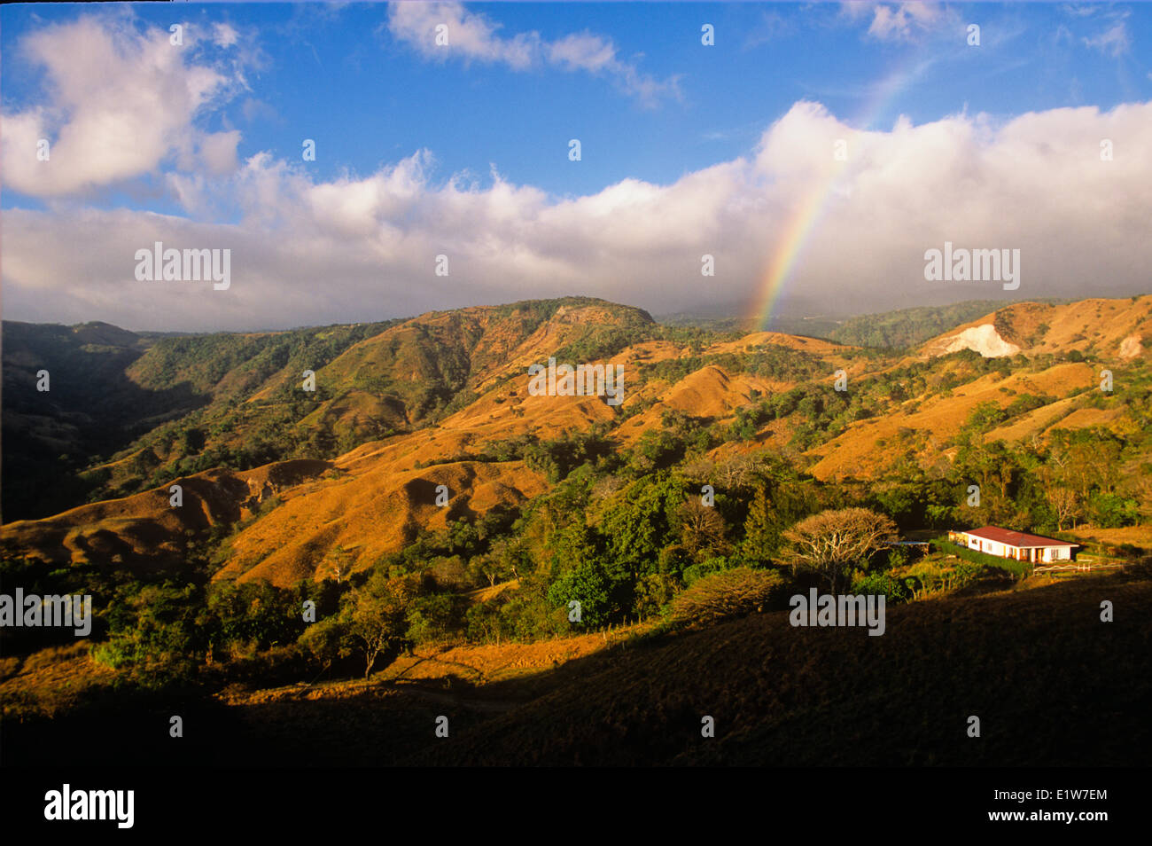 Rainbow and house, Cordillera de Tilaran, Guanacaste, Costa Rica - Stock Image