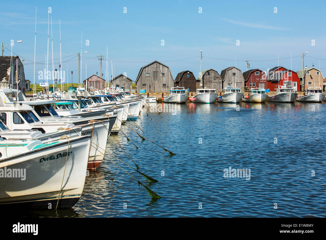 Fishing boats tied up at Malpeque Harbour wharf, Prince Edward Island, Canada - Stock Image