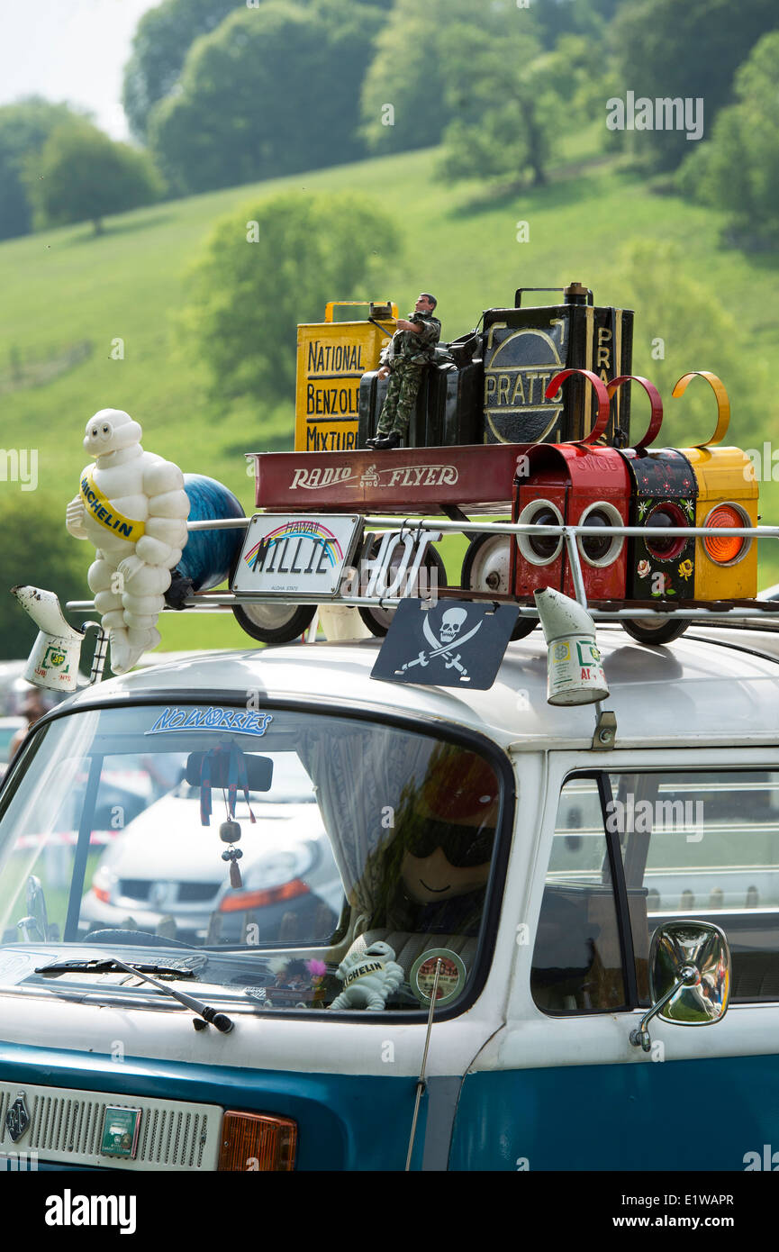 Retro collectibles on the roof rack of a Volkswagen camper van at a VW show. England - Stock Image