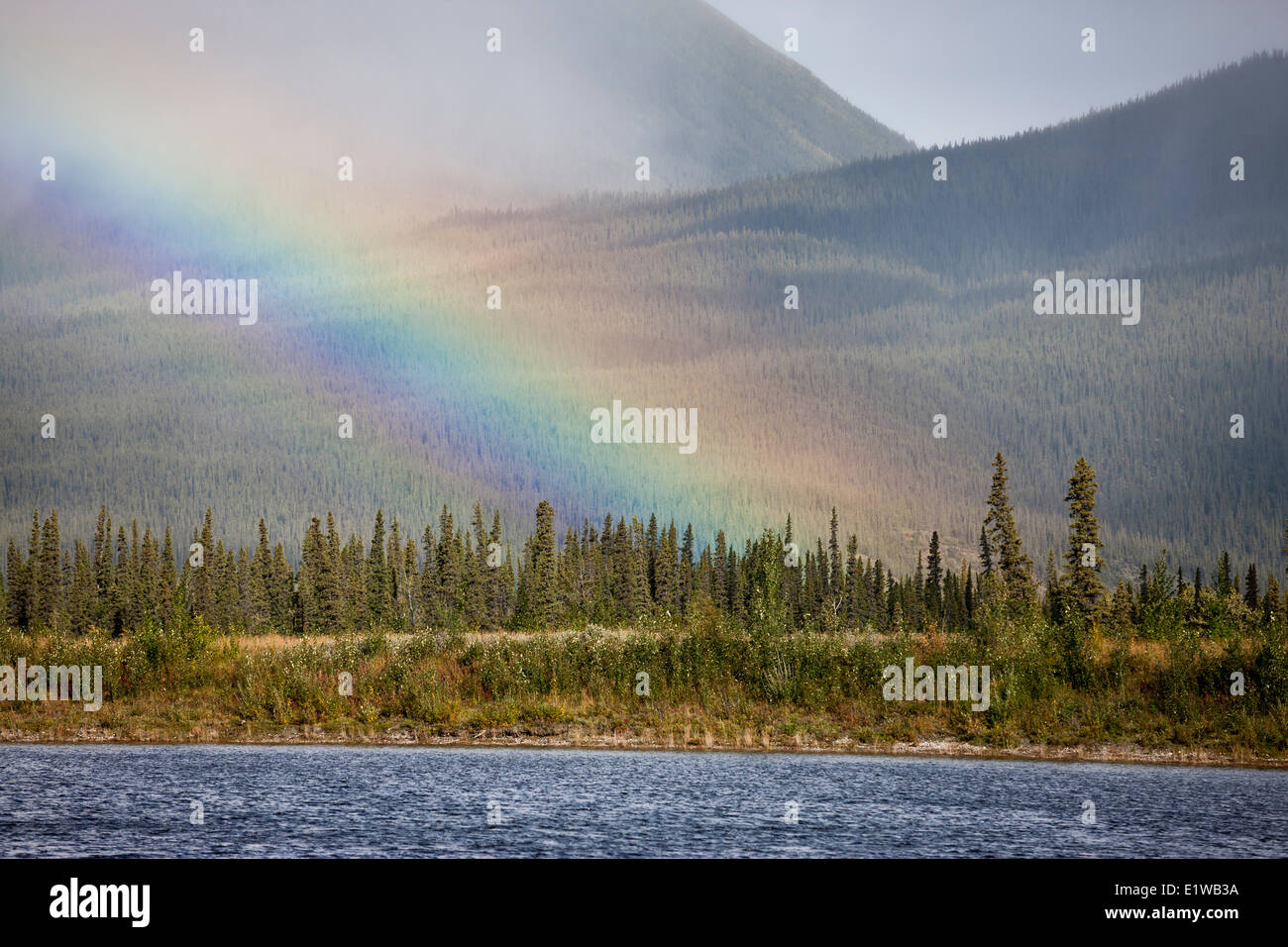 Rainbow over Kluane Lake by the Congdon Creek Campground, Yukon, Canada - Stock Image