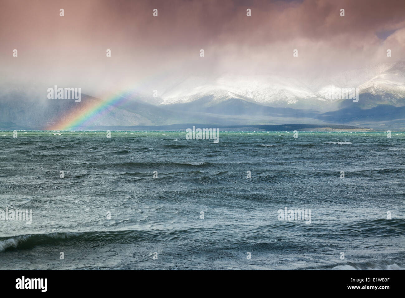 Rainbow over Kluane Lake and the Ruby Range near the Congdon Creek Campground in the Yukon, Canada - Stock Image