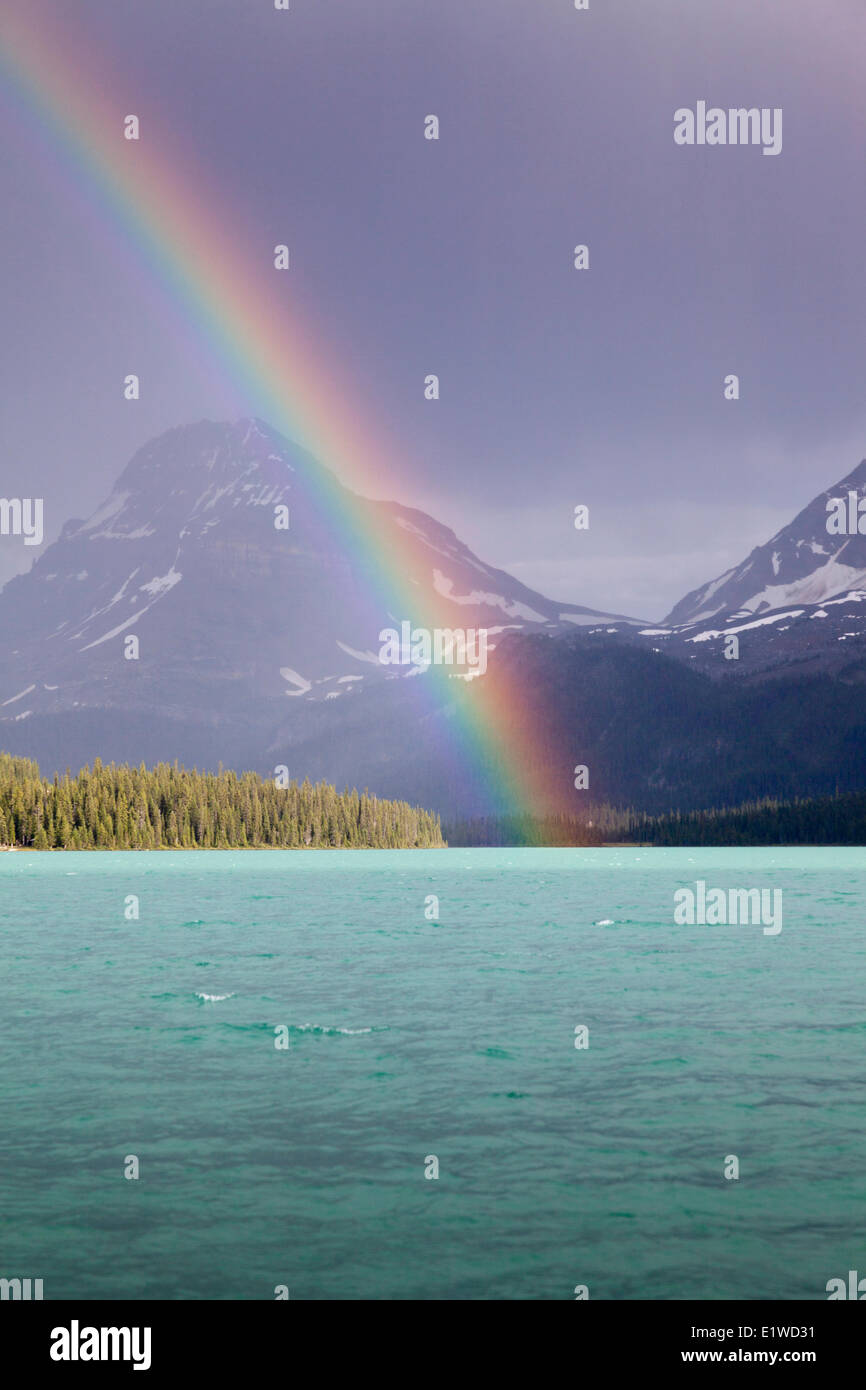 A  rainbow over Bow Lake in Banff National Park, Alberta, Canada Stock Photo