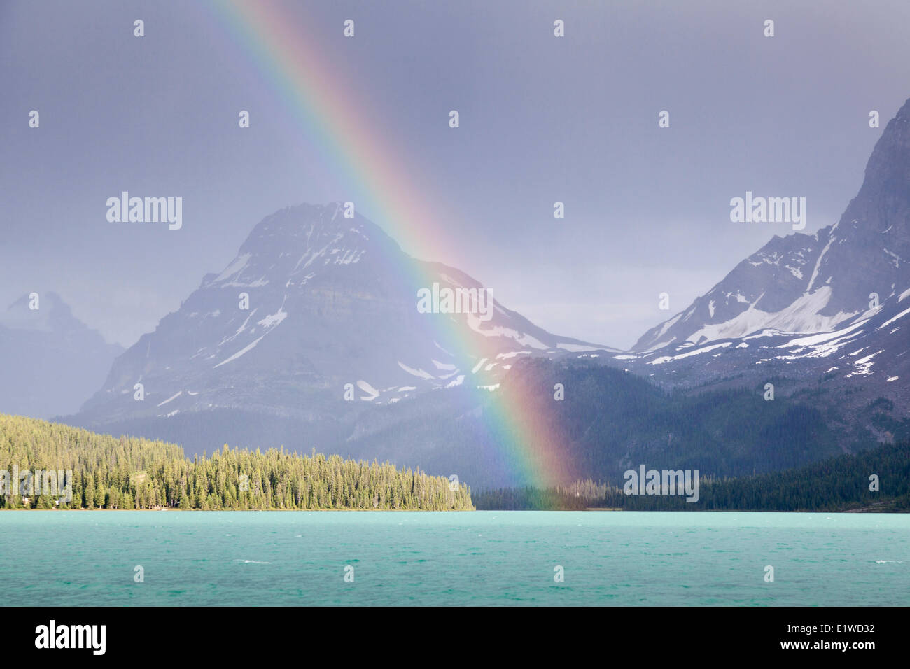 A rainbow over Bow Lake in Banff National Park, Alberta, Canada - Stock Image