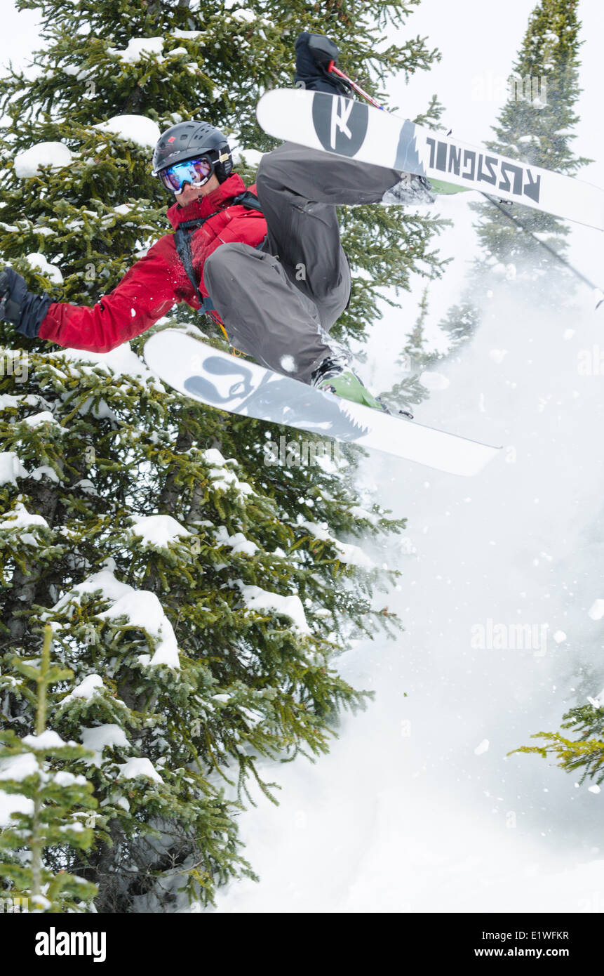 A male skier takes an out-of-control jump while skiing in the Kootenays, British Columbia - Stock Image