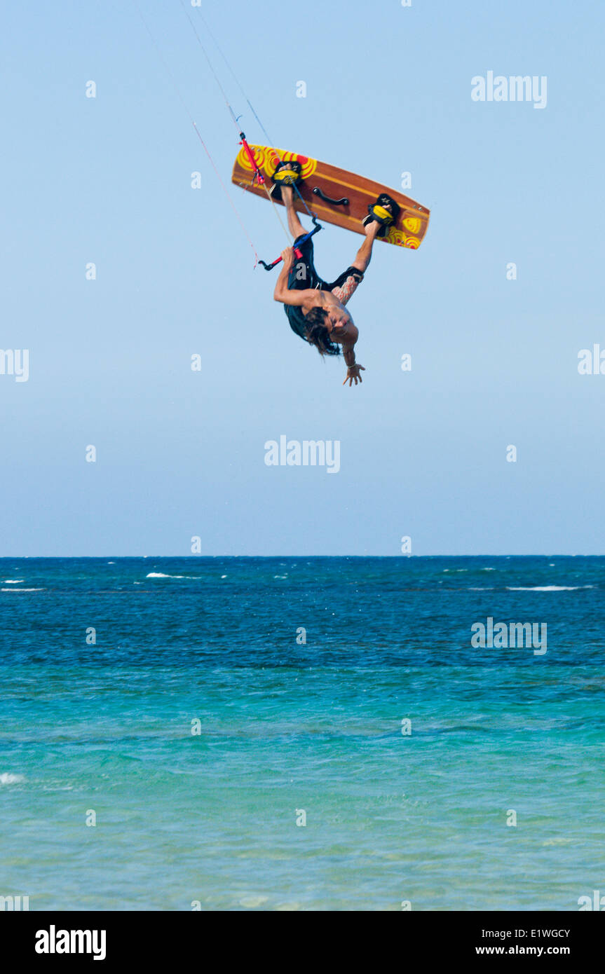 A kiteboarder is inverted on a relatively calm day, Las Terrenas, Dominican Republic - Stock Image