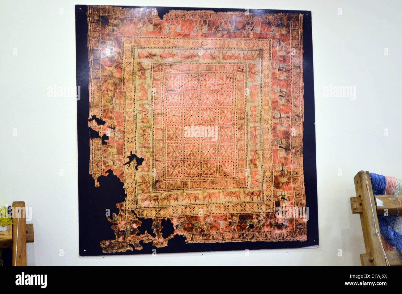 A carpet of 5000 yrs old on display at the carpet where it was made many years ago. - Stock Image