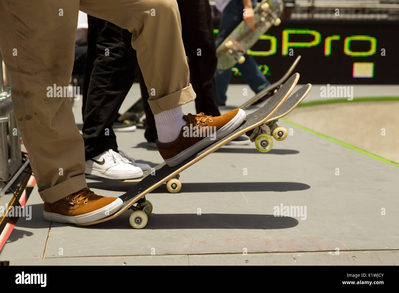 X-Games at the Circuit of the Americas held in Austin, Texas. Young skateboard athletes during practice runs - Stock Image