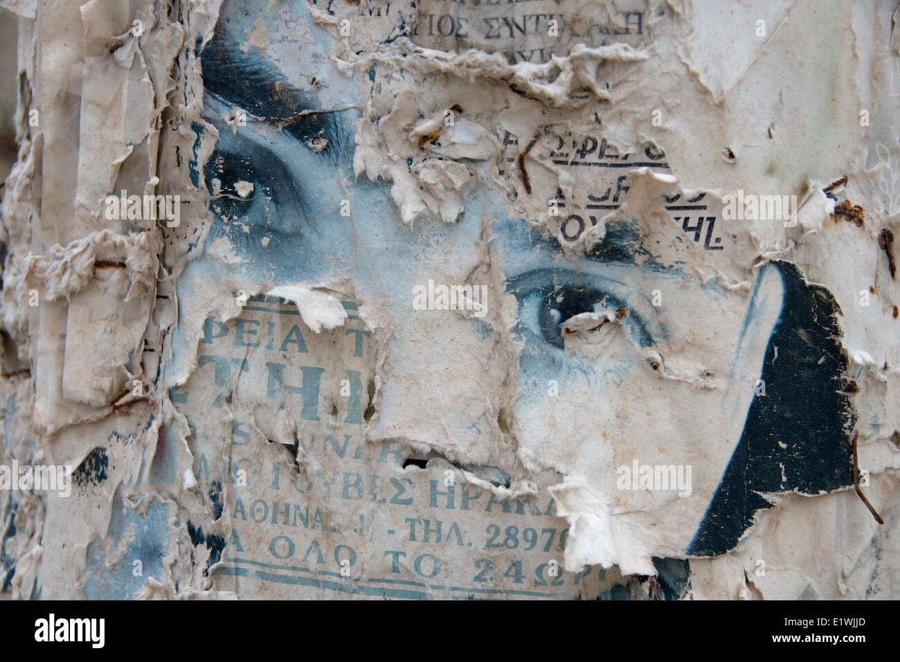 concept eyes ,  abandoned, forgotten fame, old advertisement on hydro pole, Kokkini Chani, Crete, Greece - Stock Image