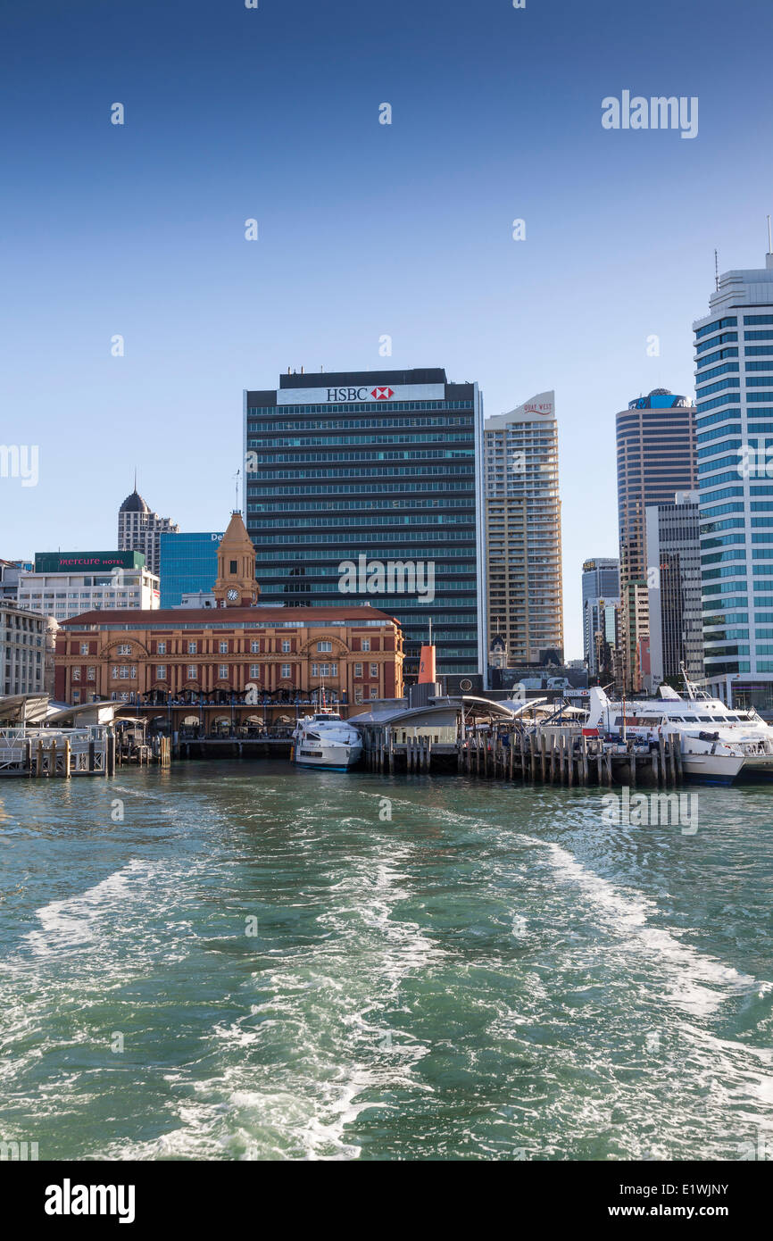 Looking back a ferry at the Auckland Ferry Terminal a historic building on the waterfront in downtown Auckland New - Stock Image