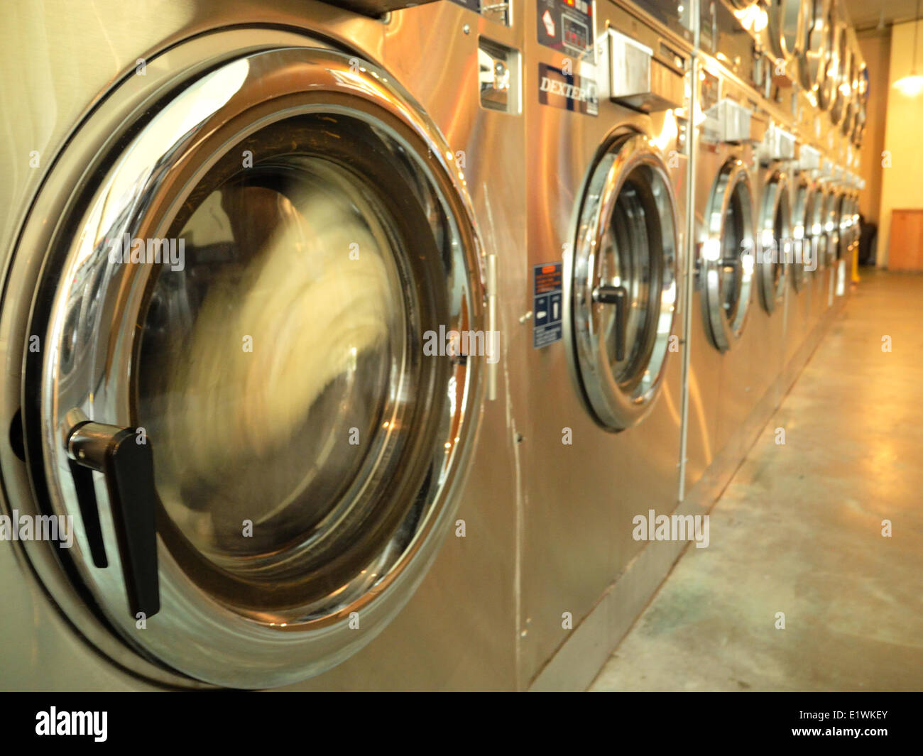 Clothes spining in laundromat - Stock Image
