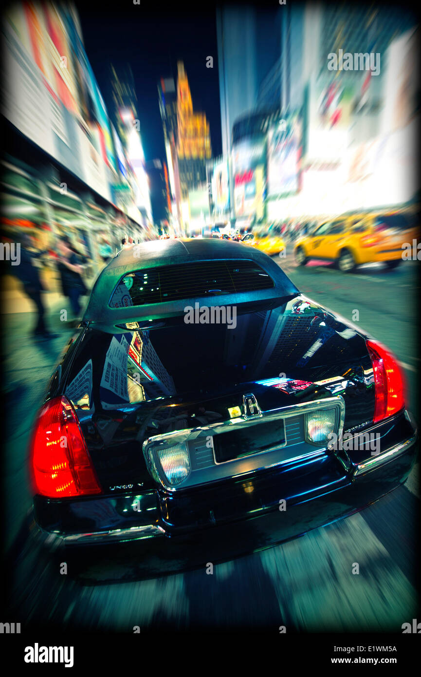 Black limousine parked at the curb on Times Square in New York City - Stock Image