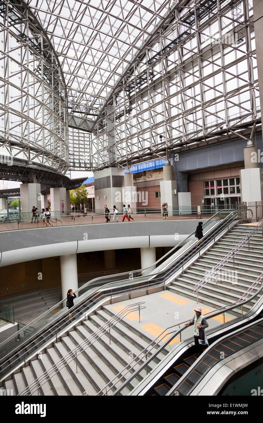 Kanazawa Station is a futuristic glass and steel train station on West Japan Railway's Hokuriku Line. The umbrella - Stock Image