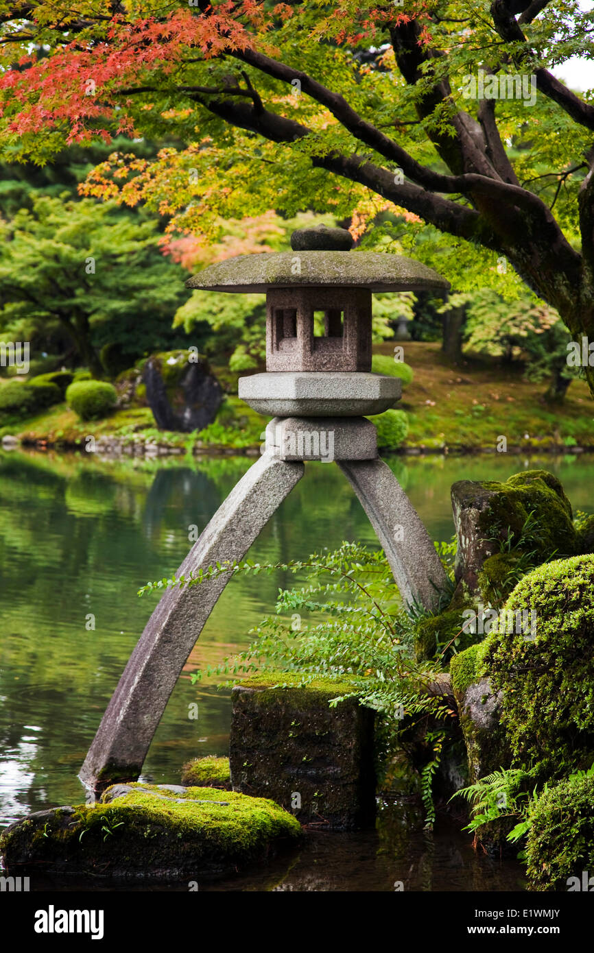 One the most beautiful gardens in Japan Kenrokuen located in Kanazawa Ishikawa Japan leg is in the water the other - Stock Image