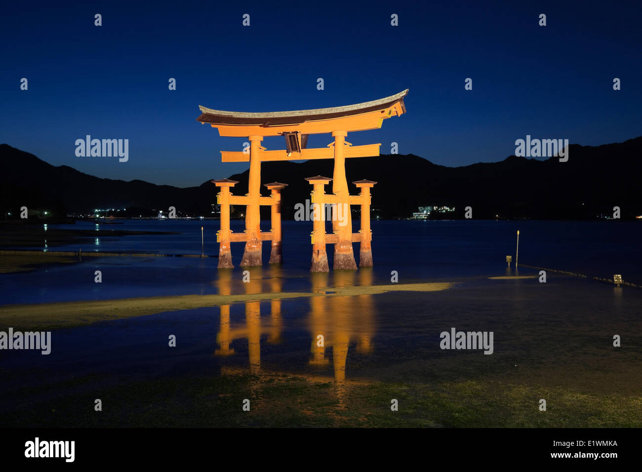 Nightime scene of the giant torii gate that is part of the Itsukushima Shrine complex on the island of Miyajima, - Stock Image