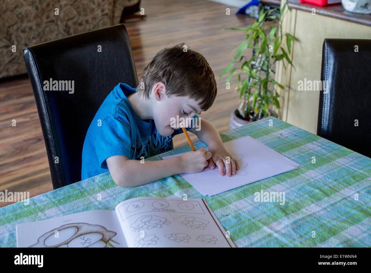 Young boy, tracing and coloring. Cranbrook, British Columbia, Canada. - Stock Image