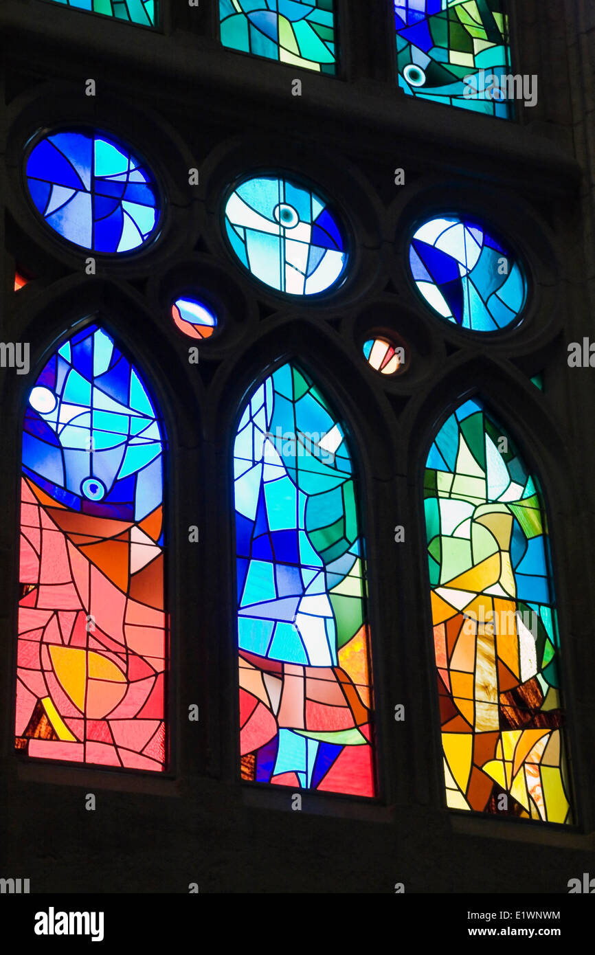 Stained glass window in the interior La Sagrada Familia Basilica by