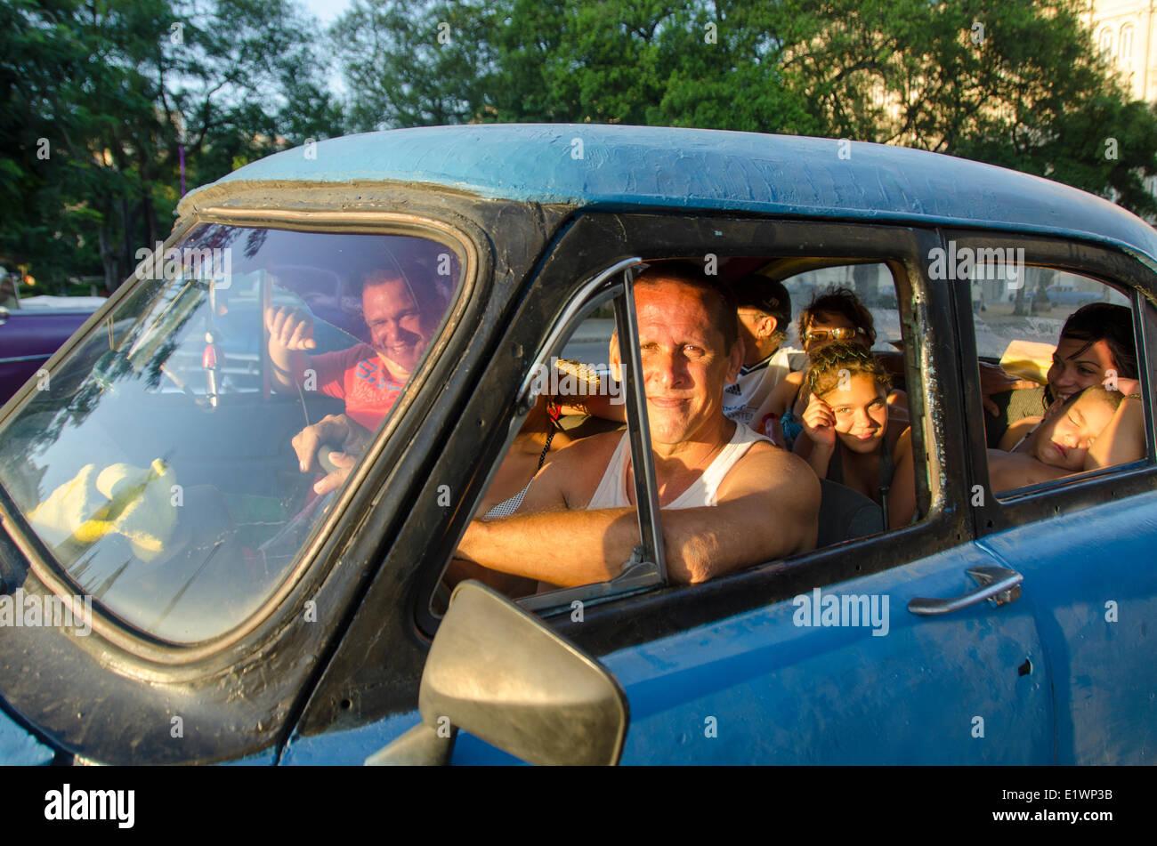 Cuban people in old car, Havana, Cuba - Stock Image
