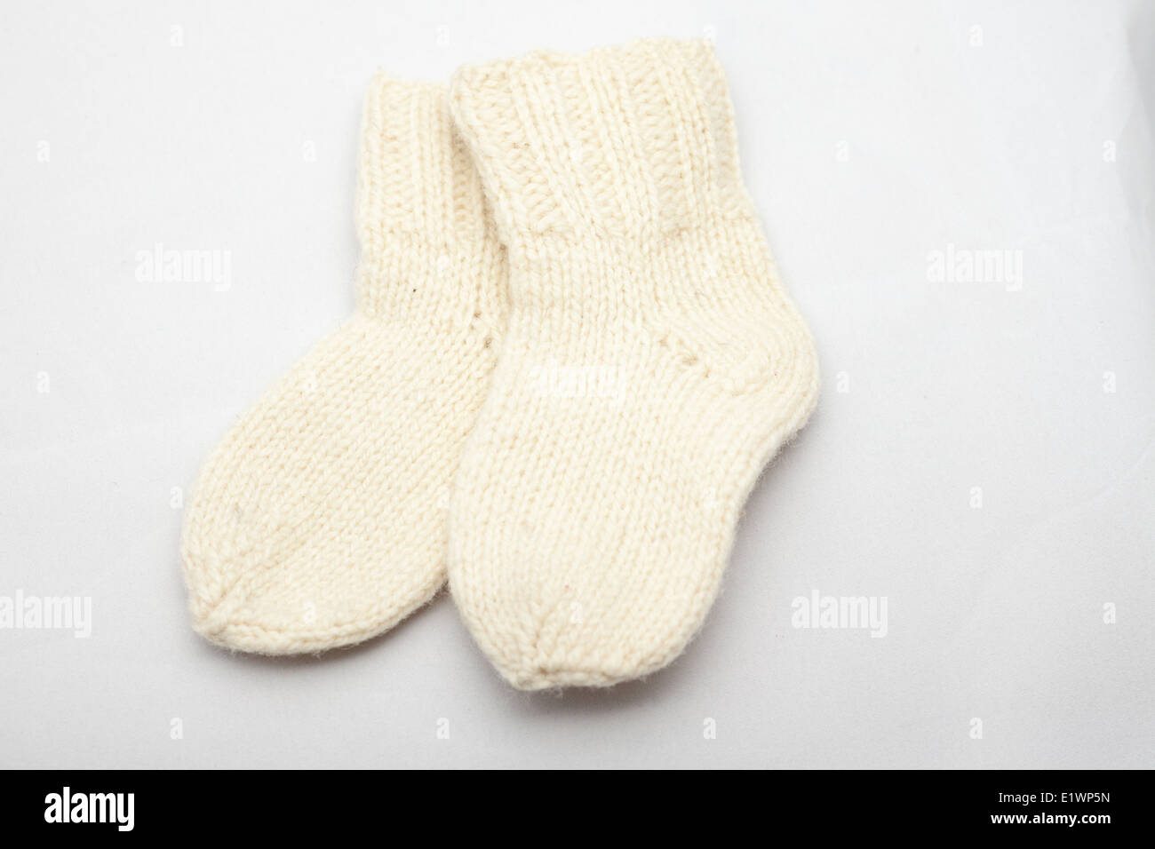 small white wool socks for a small child - Stock Image