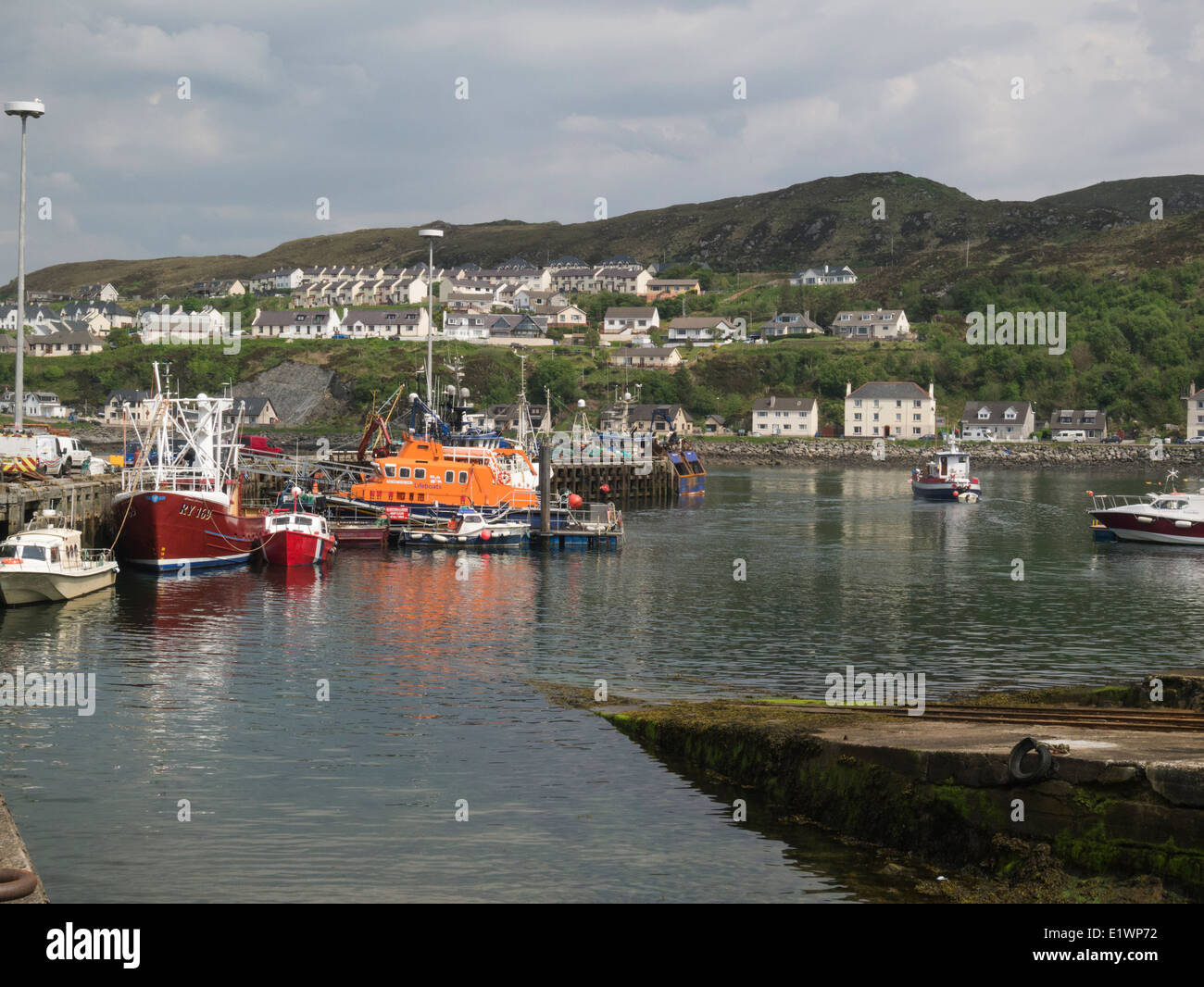 Fishing boats and lifeboat in Mallaig harbour on Scotland's west coast in the Highlands of Scotland a  port - Stock Image