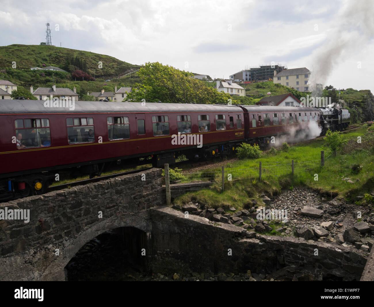 Iconic Jacobite steam train the Lancashire Fusilier leaving Mallaig village station Scottish Highlands - Stock Image