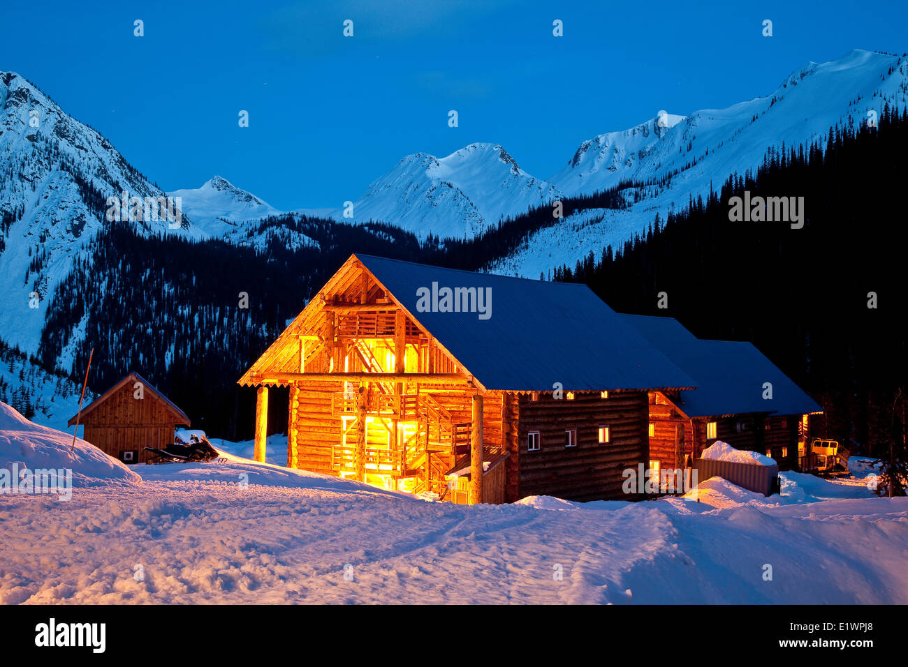 Chatter Creek Lodge in evening, Chatter Creek Catskiing, near Golden, BC, Canada. - Stock Image