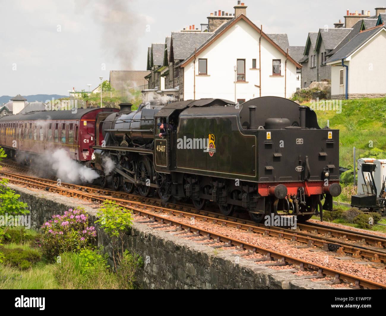 Jacobite steam train the Lancashire Fusilier leaving Mallaig village station Scottish Highlands - Stock Image