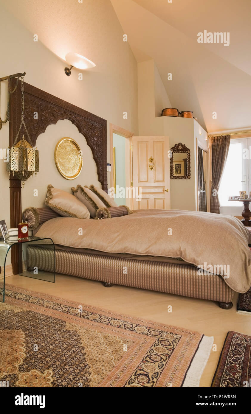 Queen size bed in the Moroccan style decorated master ...