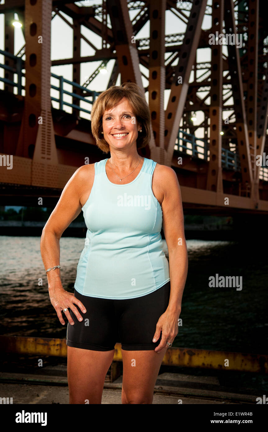 Attractive woman in her 50's in athletic wear. - Stock Image