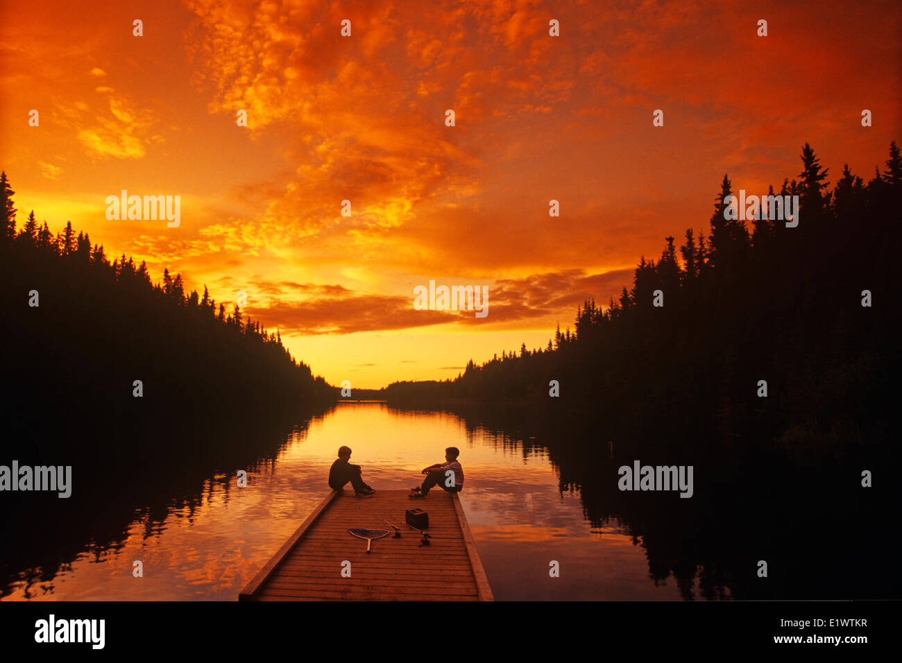 boys relaxing on dock after fishing, Duck Mountain Provincial Park, Manitoba, Canada Stock Photo