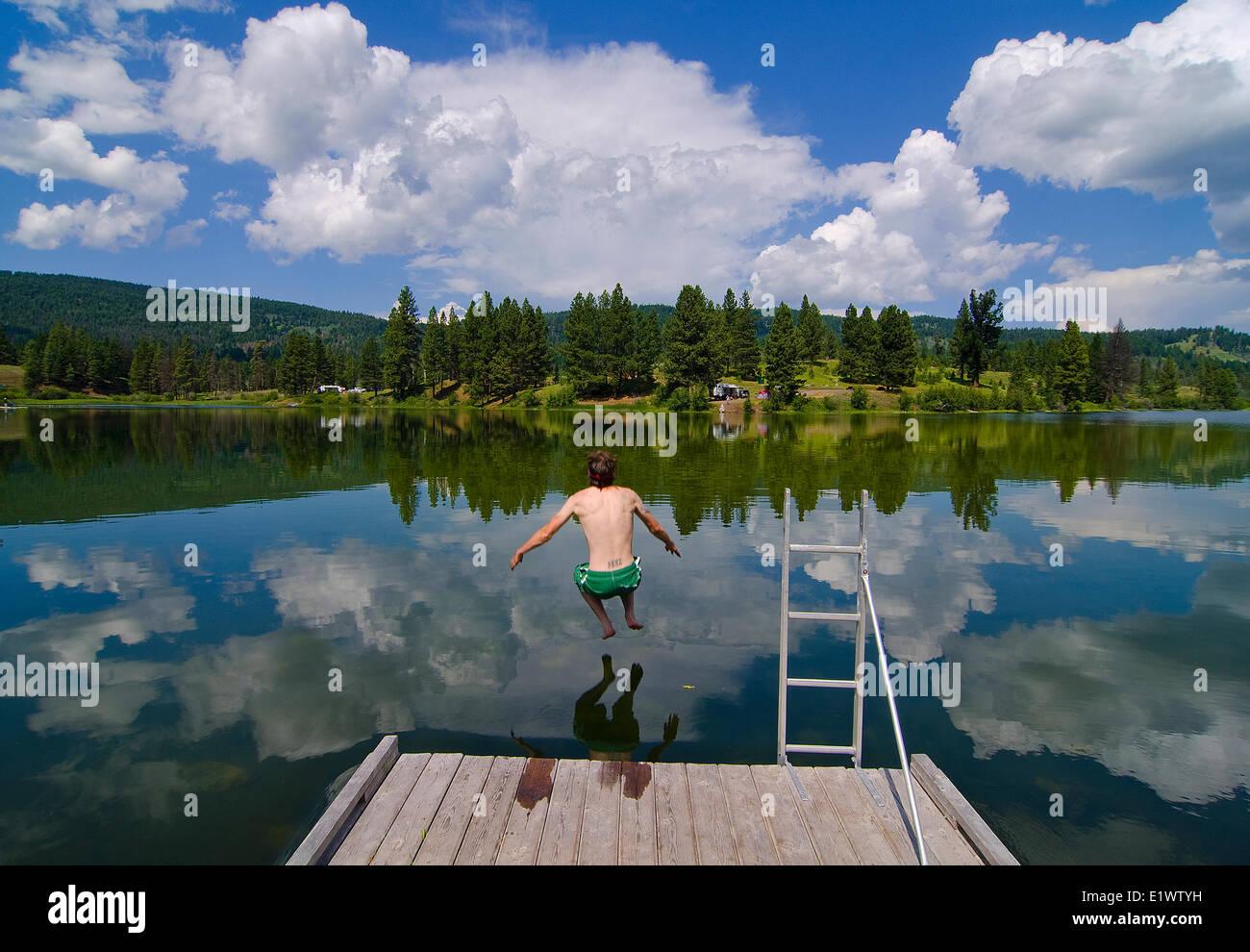 Swimming, Harmon Lake, Kane Valley, near Merritt, British Columbia, Canada. MR_001 - Stock Image