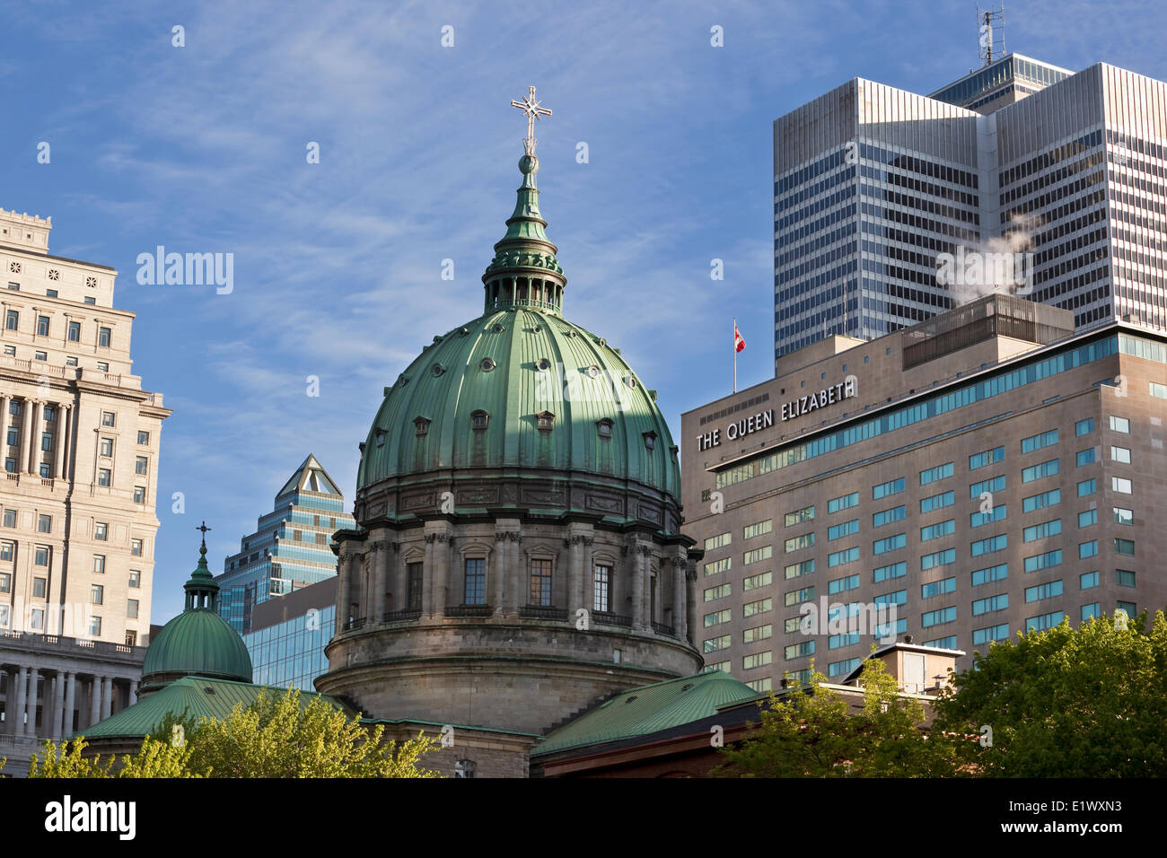 Cupola Marie-Reine-du-Monde (Marie Queen the World) Cathedral flanked on the right by The Queen Elizabeth Hotel - Stock Image