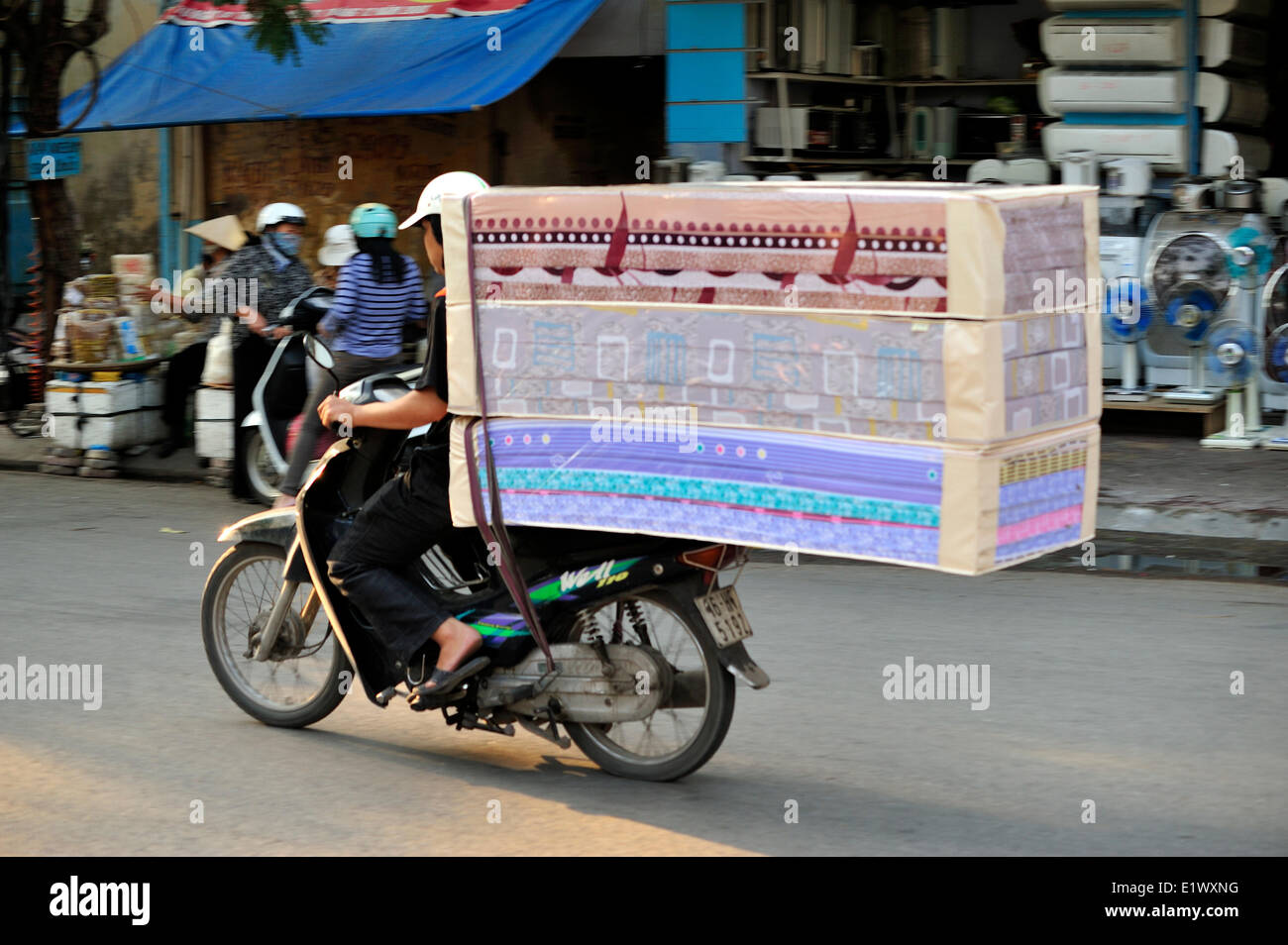 large load on a motor scooter, Haiphong, Vietnam - Stock Image