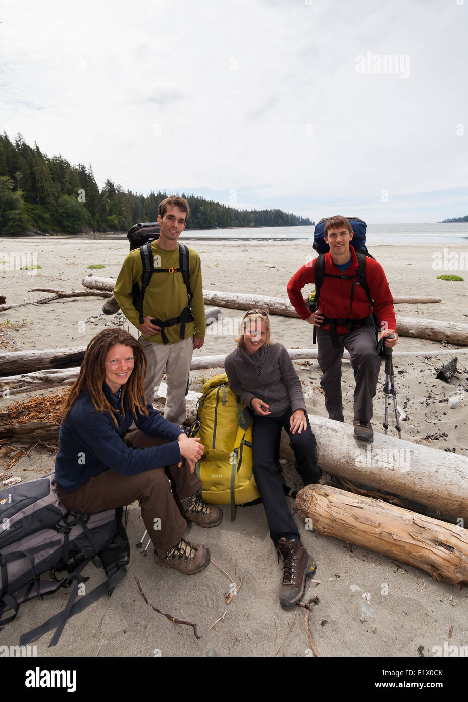 Four friends pose for a photo before embarking on their West Coast Trail adventure. Bamfield Vancouver Island British - Stock Image
