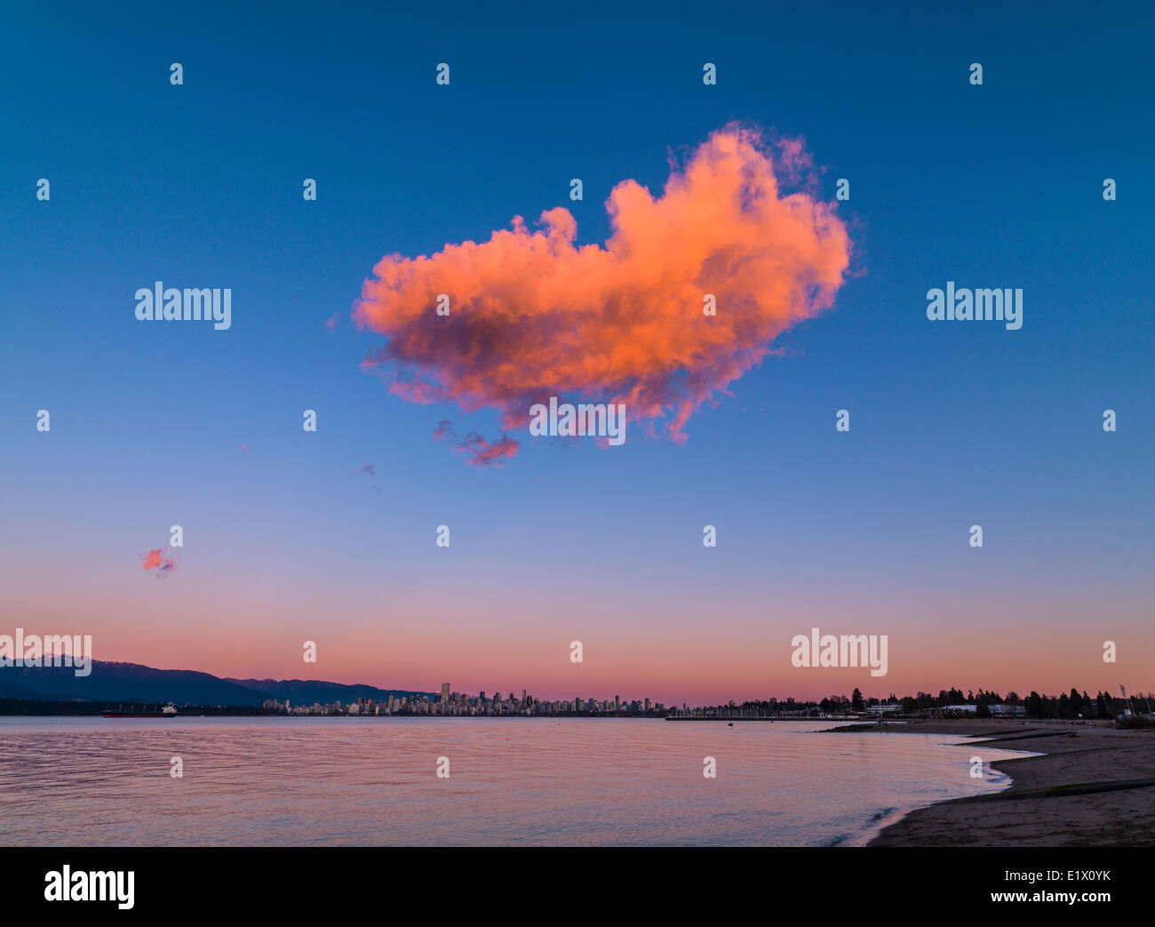 solitary cloud at sunset over Jericho Beach, Vancouver, British Columbia, Canada - Stock Image