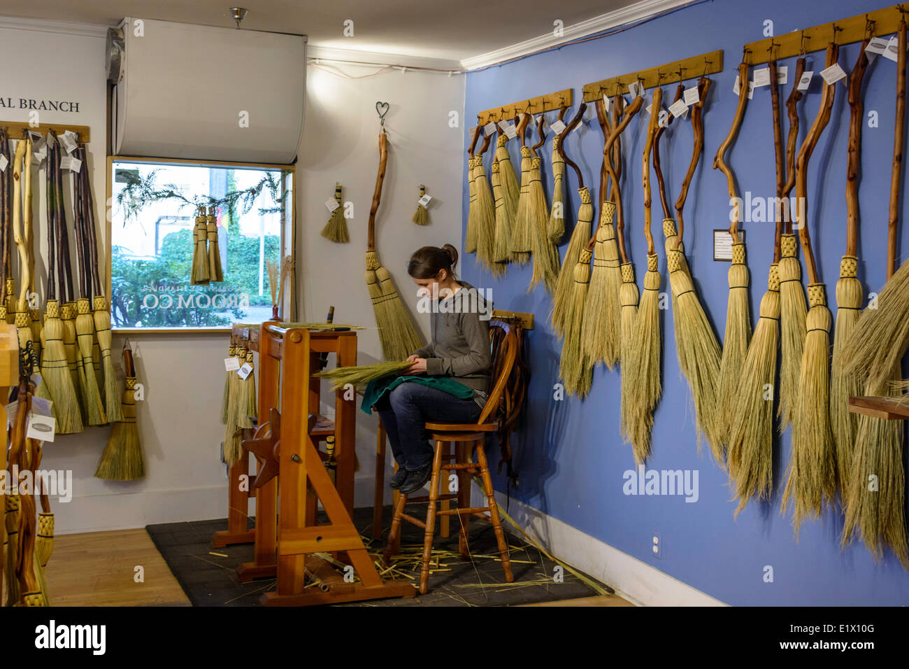 Granville Island Broom Co. makes hand-crafted brooms using traditional Shaker methods. They are designed to be both - Stock Image