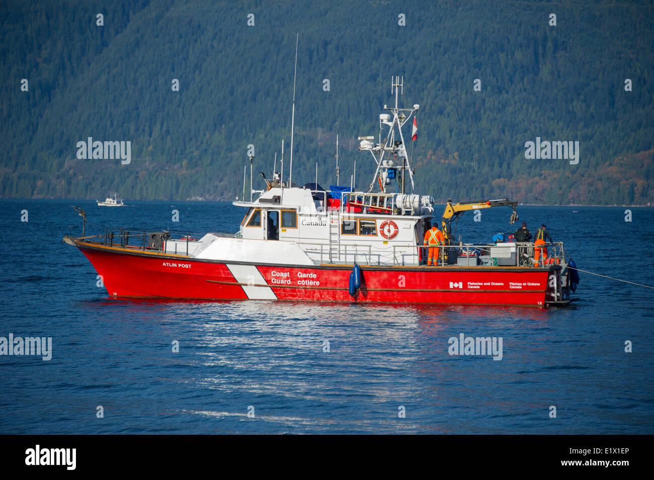 Canadian Coast Guard boat floating in Howe Sound, British Columbia, Canada - Stock Image