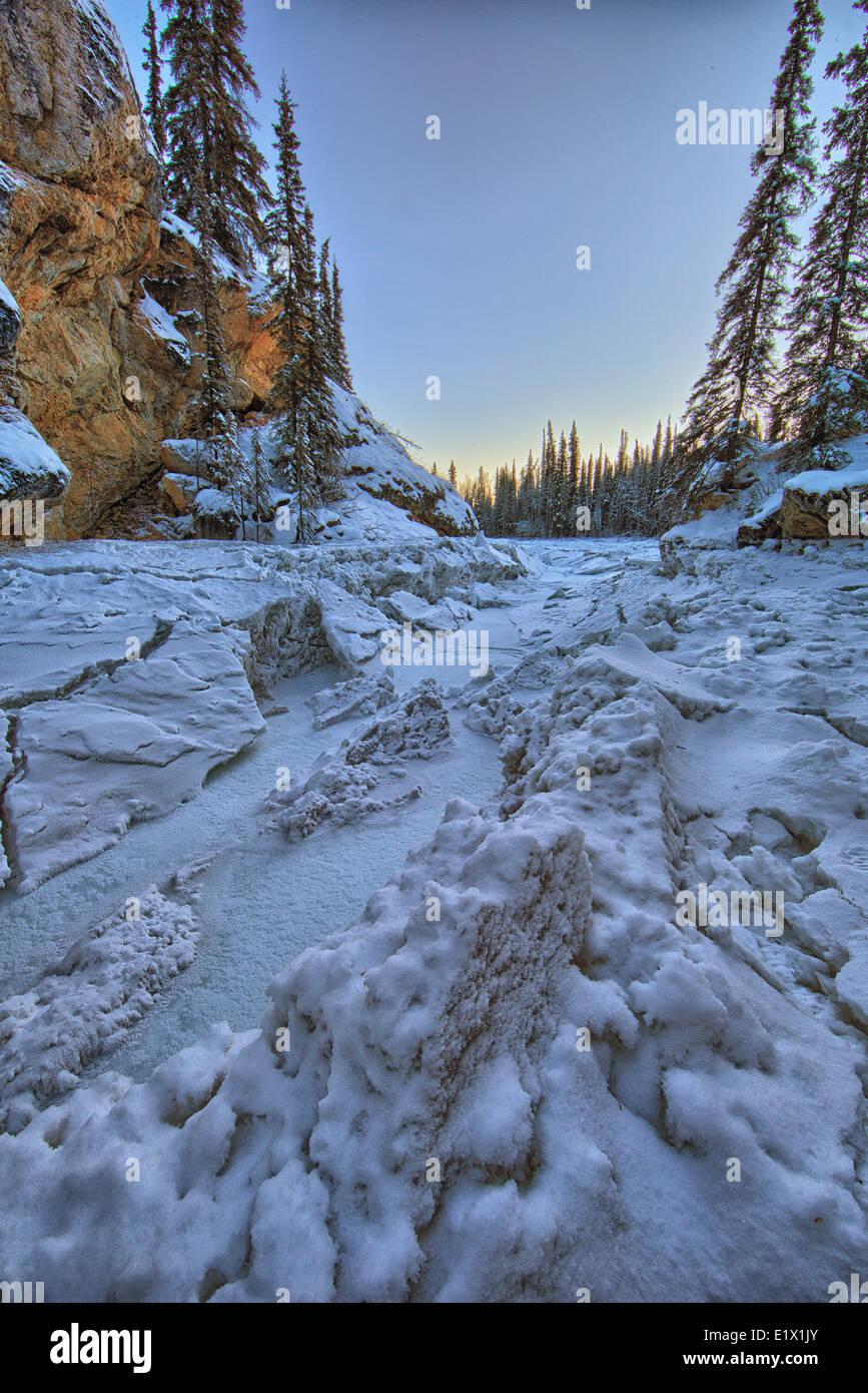 The frozen Lapie River as it heads down stream through the Lapie Canyon near Ross River,  Yukon. - Stock Image