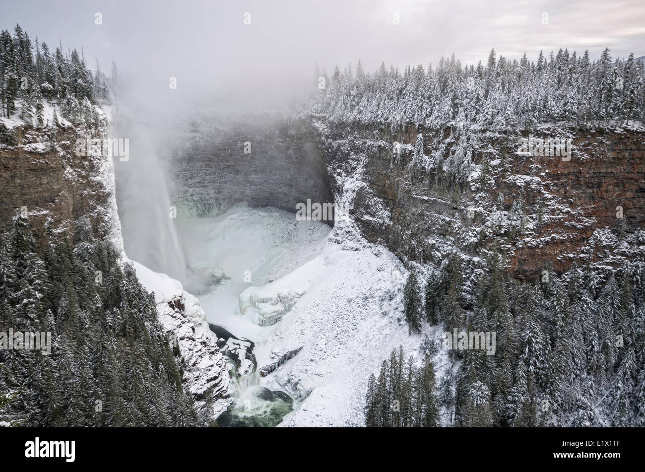 Mist cloud emanating from Helmcken Falls in the winter time in Wells