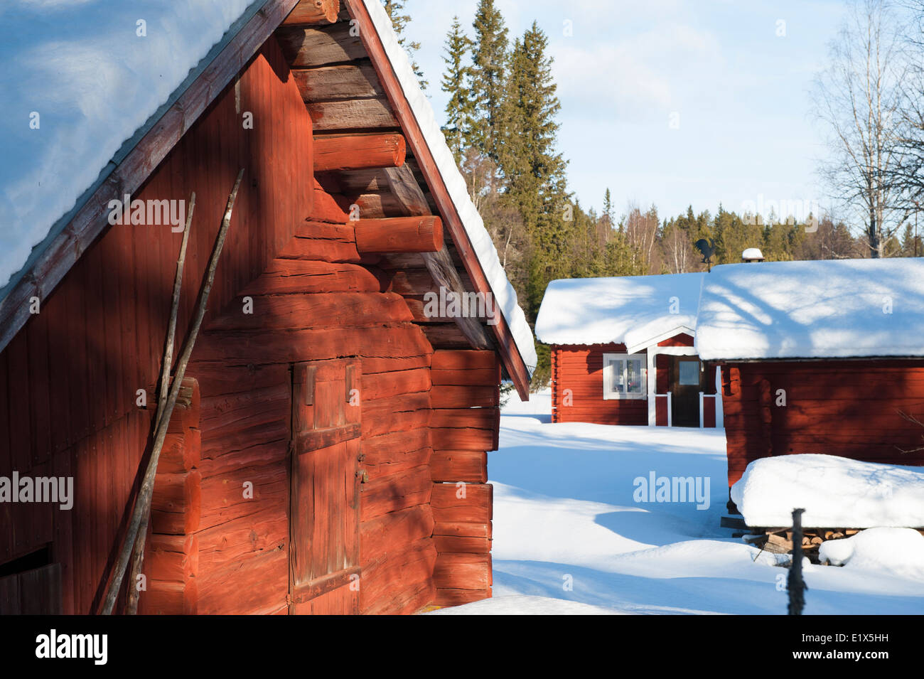 Barn and cottage in winter landscape. Dalarna, Sweden. - Stock Image