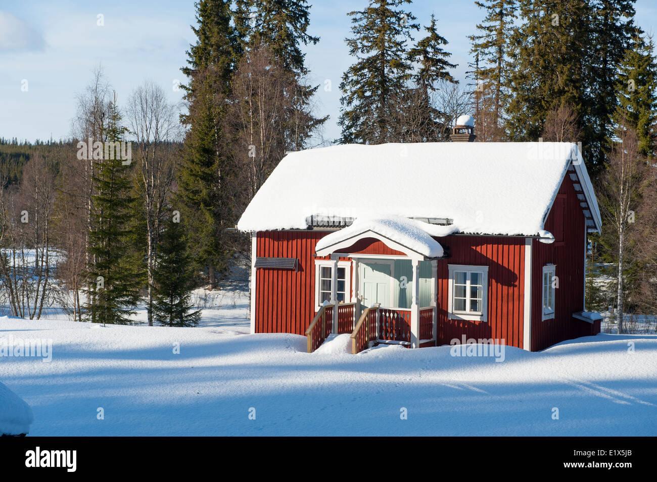 Cottage in winter landscape. Dalarna, Sweden. - Stock Image
