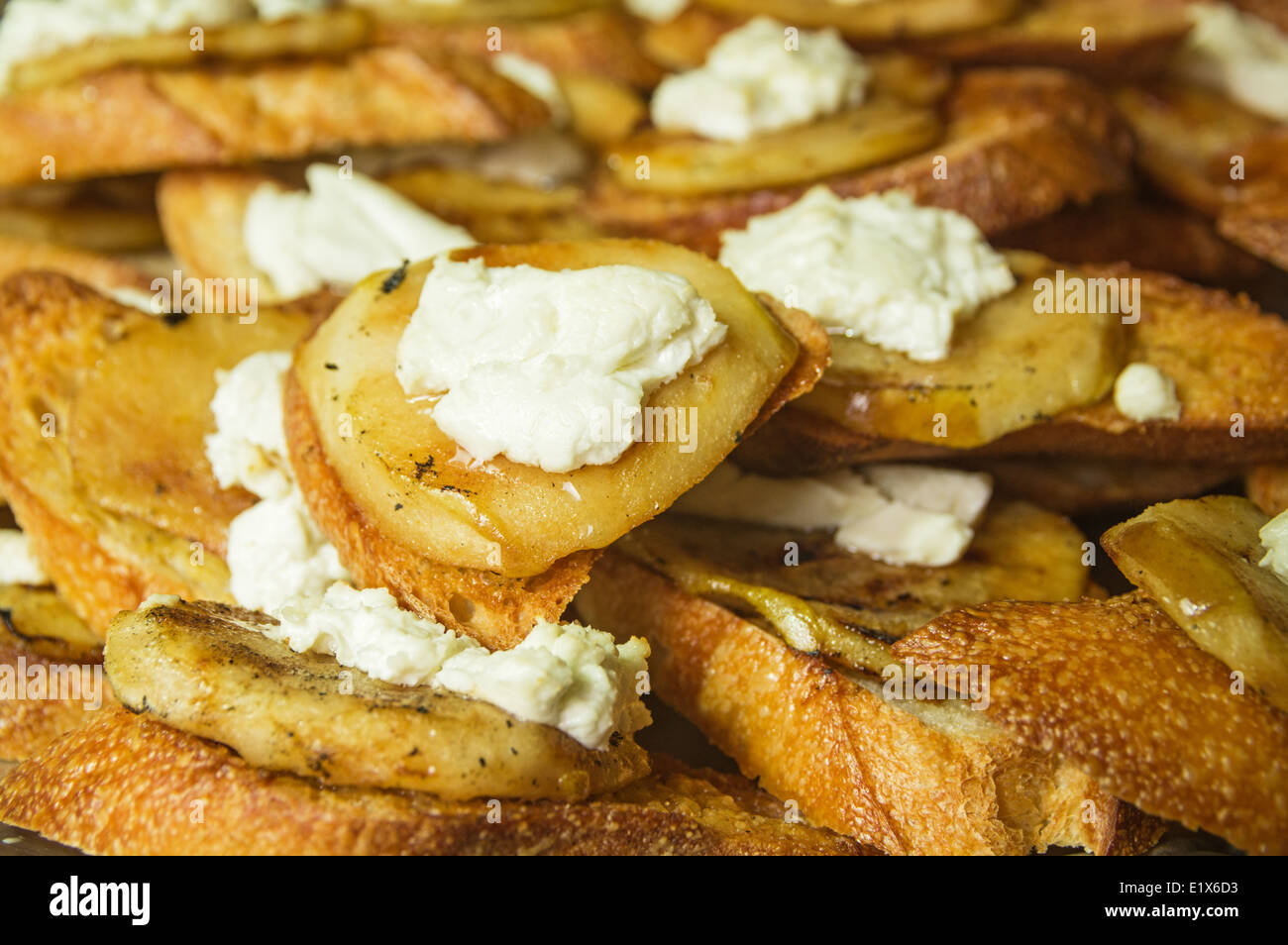 home made pear and goat cheese crostini close up detail - Stock Image
